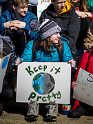 "15 MARCH 2019 - ST. PAUL, MINNESOTA, USA: A high school student holds a sign during the MN Youth for Climate Justice ""Climate Strike"" at the Minnesota State Capitol in St. Paul, MN. Thousands of high school students braved below freezing temperatures and biting winds to demand action on climate change. The Minnesota Climate Strike was inspired by the strike by Greta Thunberg, a Swedish high school student, who started a climate strike at her school in August 2018.        PHOTO BY JACK KURTZ"