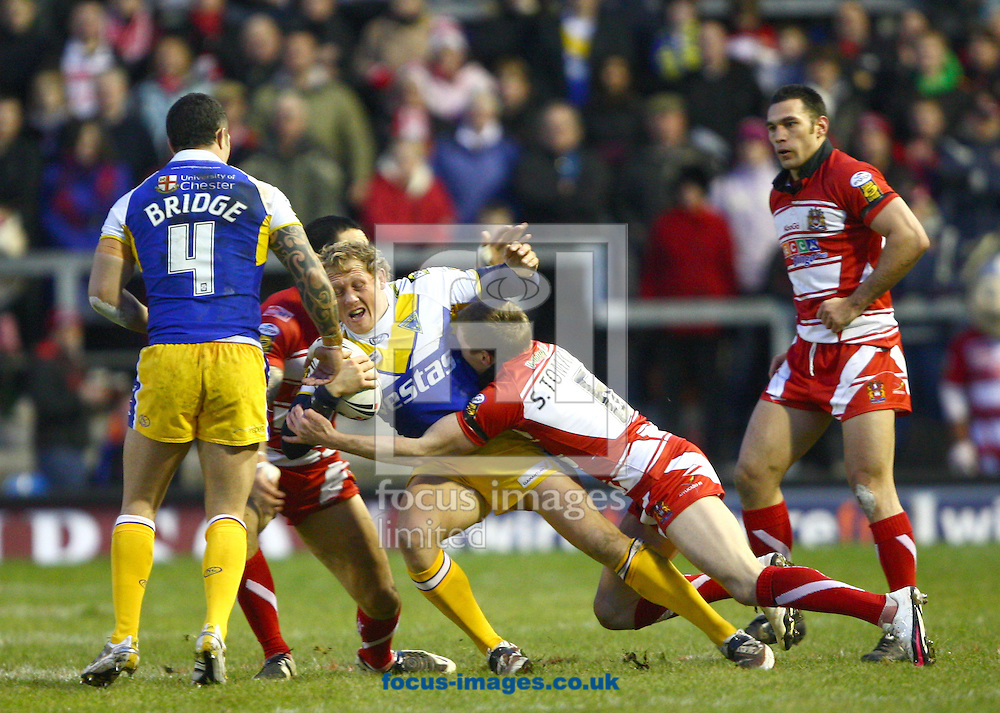 Warrington - Sunday, February 7th, 2010: Warrington's Ben Westwood is tackled by  Wigan's George Carmont (L) and Sam Tomkins (R) during the Engage Super League match at Warrington. (Pic by Andrew Stunnell/Focus Images)