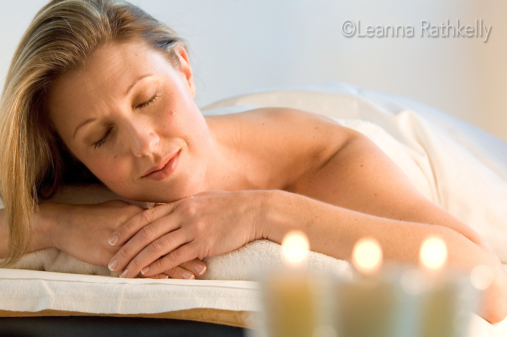 A woman relaxes while she enjoys a massage in a spa