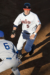Virginia Cavaliers outfielder Mike Mitchell (5) returns back to first base after a Delaware pickoff attempt.  The Virginia Cavaliers Baseball Team defeated the Delaware Blue Hens 11-2 in the first of a three game series at Davenport Field in Charlottesville, VA on March 2, 2007.