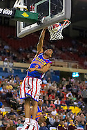 04 May 2006: Scooter McFadgon (6) goes up for a dunk in the Harlem Globetrotters vs the New York Nationals at the Sulivan Arena in Anchorage Alaska during their 80th Anniversary World Tour.  This is the first time in 10 years that the Trotters have visited Alaska.