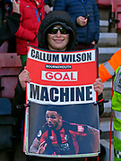 "A young Bournemouth fan with a banner saying ""Callum Wilson Bournemouth Goal Machine"" during the Premier League match between Bournemouth and Arsenal at the Vitality Stadium, Bournemouth, England on 25 November 2018."