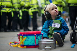 © Licensed to London News Pictures. 04/10/2017. Manchester, UK.  A child protests about homelessness during the demonstration on the final day of the Tory Party Conference. The protest was as part of the Take Back Manchester festival to protest the conference taking part in the city.  Photo credit: Steven Speed/LNP