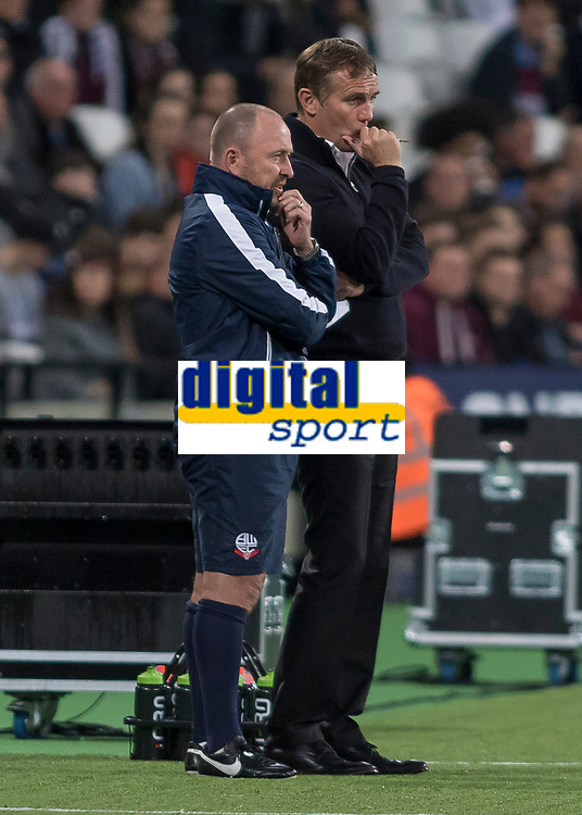 Football - 2017 / 2018 EFL (League) Cup - Third Round: West Ham United vs. Bolton Wanderers<br /> <br /> Bolton Wanderers Manager Phil Parkinson and his assistant discuss their half time team talk with a minute to go at the London Stadium.<br /> <br /> <br /> COLORSPORT/DANIEL BEARHAM
