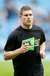 James Milner of Manchester City warms up in a tshirt supporting the Kick it Out campaign against racism and discrimination in football - Photo mandatory by-line: Rogan Thomson/JMP - 07966 386802 - 18/10/2014 - SPORT - FOOTBALL - Manchester, England - Etihad Stadium - Manchester City v Tottenham Hotspur - Barclays Premier League.