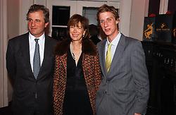 Left to right, VISCOUNT & VISCOUNTESS ASTOR and their son the HON.JAKE ASTOR at a party hosted by jeweller Theo Fennell and Dominique Heriard Dubreuil of Remy Martin fine Champagne Cognac entitles 'Hot Ice' held at 35 Belgrave Square, London, W1 on 26th October 2004.<br />