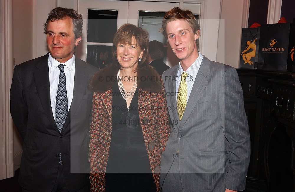 Left to right, VISCOUNT &amp; VISCOUNTESS ASTOR and their son the HON.JAKE ASTOR at a party hosted by jeweller Theo Fennell and Dominique Heriard Dubreuil of Remy Martin fine Champagne Cognac entitles 'Hot Ice' held at 35 Belgrave Square, London, W1 on 26th October 2004.<br />