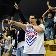 Kris Wilson/News Tribune<br /> Jennifer Hembree, center, points back to her son, Seneca wrestler Dalton Hembree as he points from the mat to his loud cheering section following his win by fall over Marceline's Dylan Wheeler in the Class 1 120-pound championship match during the 2016 MSHSAA Wrestling State Championships at Mizzou Arena in Columbia.