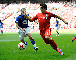 Luis Suarez of Liverpool (right) with Leon Osman of Everton during the Budweiser FA Cup semi final match between Liverpool and Everton at Wembley on Saturday 14 April 2012 (Photo by Rob Munro)