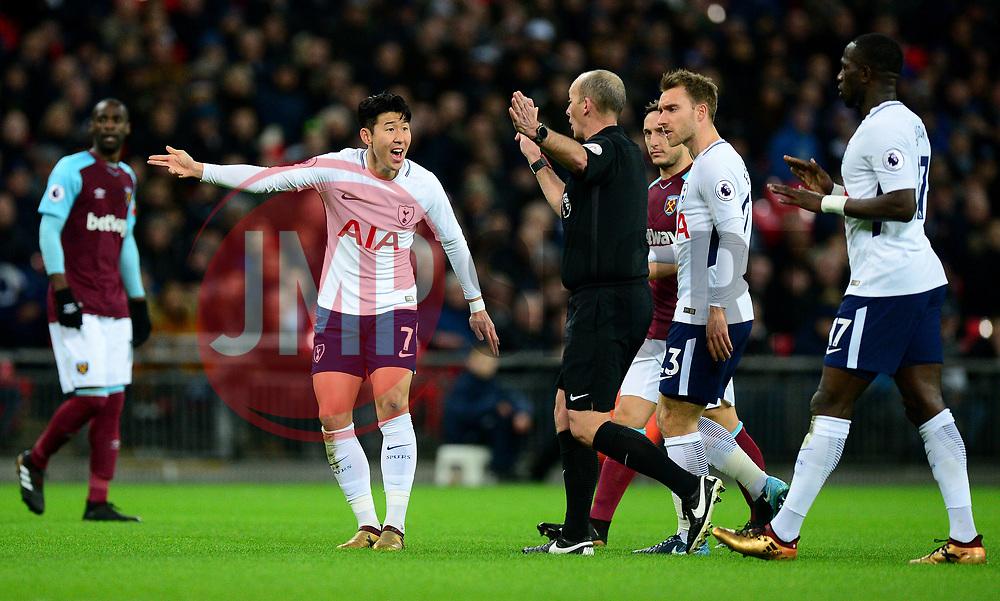 Son Heung-Min of Tottenham Hotspur complains to referee Mike Dean after a foul is given against him.  - Mandatory by-line: Alex James/JMP - 04/01/2018 - FOOTBALL - Wembley Stadium - London, England - Tottenham Hotspur v West Ham United - Premier League