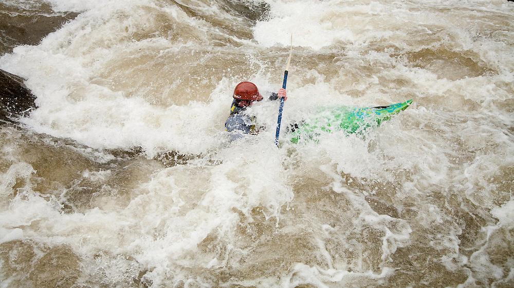 Kayaker descending the rapids on the New Haven River outside Bristol, VT.