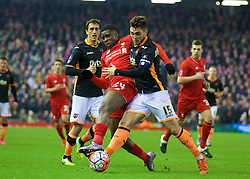 LIVERPOOL, ENGLAND - Wednesday, January 20, 2016: Liverpool's Sheyi Ojo in action against Exeter City's Jordan Moore-Taylor during the FA Cup 3rd Round Replay match at Anfield. (Pic by David Rawcliffe/Propaganda)