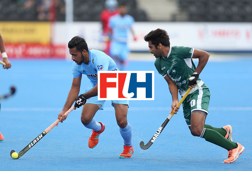 LONDON, ENGLAND - JUNE 24:  Harmanpreet Singh of India and Ali Shan of Pakistan battle for possession  during the 5th-8th place match between Pakistan and India on day eight of the Hero Hockey World League Semi-Final at Lee Valley Hockey and Tennis Centre on June 24, 2017 in London, England.  (Photo by Steve Bardens/Getty Images)