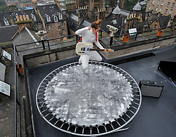 "Pictured: Performer Zoe Ni Riordain complete with guitar limbers up on her trampoline atop Camera Obscura before her Fringe show 'Everything I do""<br /> <br /> Fringe performers final preparations for the start of the 2019 Fringe.<br /> <br /> © Dave Johnston / EEm"