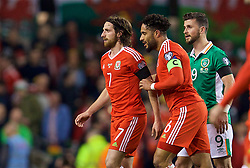 DUBLIN, REPUBLIC OF IRELAND - Friday, March 24, 2017: Wales' Joe Allen clashes with Republic of Ireland's Shane Long as captain Ashley Williams ushers him away during the 2018 FIFA World Cup Qualifying Group D match at the Aviva Stadium. (Pic by David Rawcliffe/Propaganda)