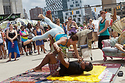 Eleanor Bramwell of Sanctuary Body Works and an unidentified man do Arco Yoga during Artscape in Baltimore, MD on Sunday, July 21, 2013.