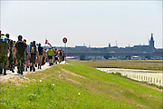 Nederland, the Netherlands, Nijmegen, 19-7-2016 Op de Wedren startten om 4 uur de eerste lopers van de 100e 4 daagse. Via de Waalbrug ging het naar de Betuwe en via de Oosterhoutsedijk in een langgerekt lint weer terug. The International Four Day Marches Nijmegen, or Vierdaagse, is the largest marching event in the world. It is organised every year in Nijmegen in mid-July as a means of promoting sport and exercise. Participants walk 30, 40 or 50 kilometers daily, and, on completion, receive a royally approved medal, Vierdaagsekruis. The participants are mostly civilians, but there are also a few thousand military participants. The vierdaagse, Dutch for Four day Event, is an annual walk that has taken place since 1909, being based at Nijmegen since 1916. Foto: Flip Franssen