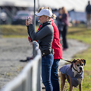 Katlyn Hewson-Slezak taking a video of her husband Karl Slezak in the dressage ring at the Red Hills International Horse Trials in Tallahassee, Florida.
