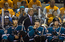 April 22, 2010; San Jose, CA, USA; San Jose Sharks head coach Todd McLellan (top) watches the game during the first period of game five in the first round of the 2010 Stanley Cup Playoffs against the Colorado Avalanche at HP Pavilion.  San Jose defeated Colorado 5-0. Mandatory Credit: Jason O. Watson / US PRESSWIRE