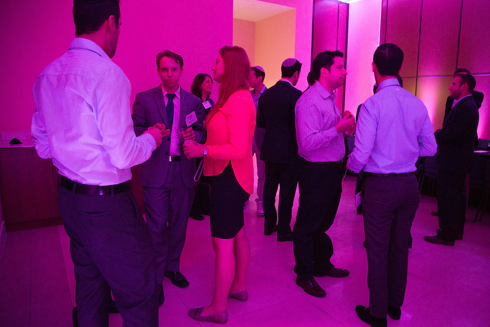 FEBRUARY 5, 2015----MIAMI, FLORIDA---PHOTO BY ANGEL VALENTIN<br /> Cocktails and refreshments are served to attendants in a colorfully  lit room Rok Family Shul Chabad Downtown Jewish Center in the Brickell area of Miami. The center hosted a networking roundtable event for young Jews, mostly non-Orthodox. Real Estate investment and development was the topic discussed.