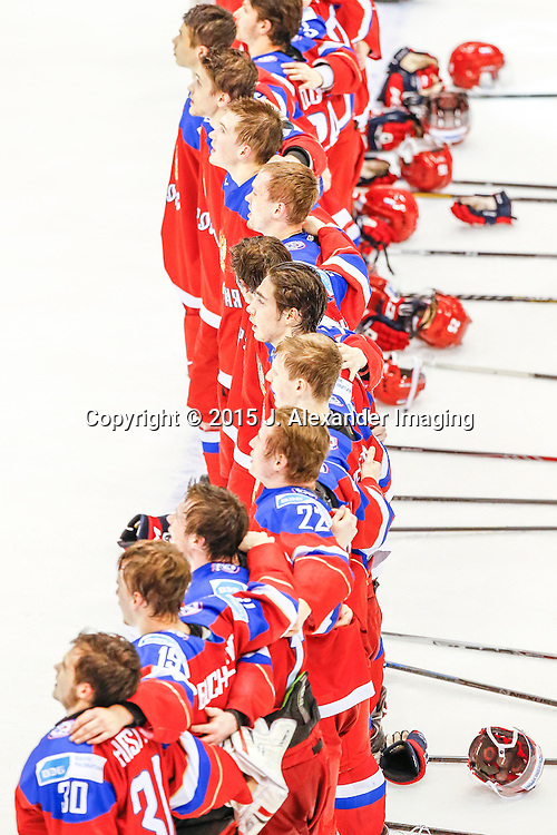 Team Russia sings their national anthem after winning game during the 2015 IIHF Junior World Championships.