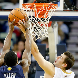 Dec 13, 2013; New Orleans, LA, USA; New Orleans Pelicans center Jason Smith (14) defends against Memphis Grizzlies shooting guard Tony Allen (9) during the first half of a game at New Orleans Arena. Mandatory Credit: Derick E. Hingle-USA TODAY Sports