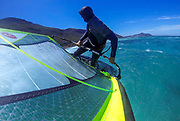 A windsurfer performs a forward loop whilst sailing in the Atlantic Ocean off Witsands on the Cape peninsula of Cape Town, South Africa 18 November 2014. With a coastline stretching more than 2,500 kilometers, South Africa has a large number of water sports enthusiasts. During the summer months between November and February wind sports in the Cape are extreemly popular due to the prevailing strong winds attracting thousands of foreign sailors to its shores.