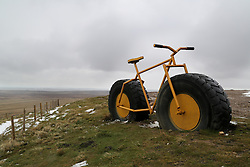 © Licensed to London News Pictures. 29/04/2016. Pateley Bridge, UK. A huge bike made witch truck wheels marks the summit of Greenhow Hill near Pateley Bridge in North Yorkshire. The steep climb which reaches 2.8km was the only climb during the opening stage of the 2016 Tour De Yorkshire. The three-day road cycling race held annually across Yorkshire is in it's second year. Photo credit : Ian Hinchliffe/LNP