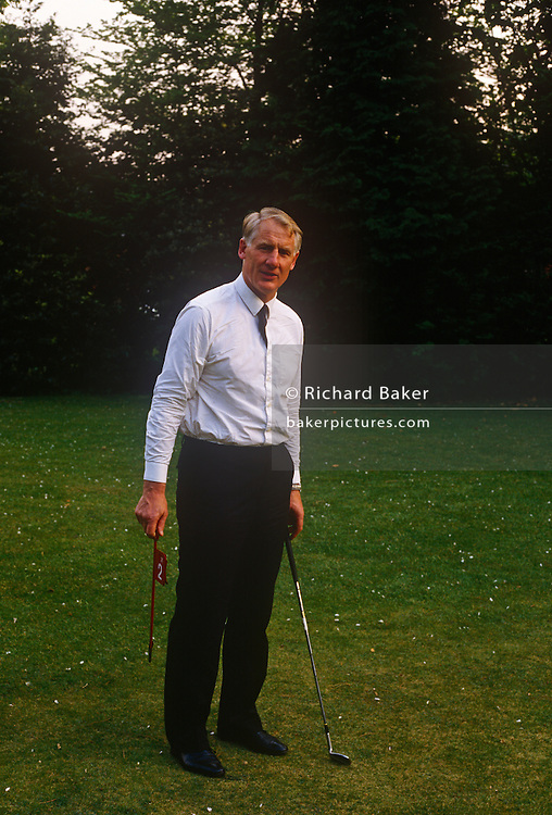 A portrait of British senior civil servant, Sir Robin Butler while practicing putting in the summer of 1989, at the Civil Service College at Sunningdale, England. Butler had a high-profile career in the civil service from 1961 to 1998, serving as Private Secretary to five Prime Ministers. He was Secretary of the Cabinet and Head of the Home Civil Service from 1988 to 1998. Frederick Edward Robin Butler, Baron Butler of Brockwell, KG, GCB, CVO, PC (b1938) is a retired British civil servant, now sitting in the House of Lords as a crossbencher.