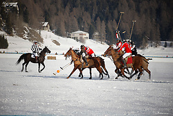 Bautista Ortiz de Urbina of team Switzerland going for the ball<br /> St.Moritz Polo World Cup On Snow 2011<br /> © Dirk Caremans