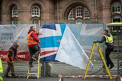 © Licensed to London News Pictures. 04/10/2017. Manchester, UK.  Workmen removing a Conservative Party banner after the demonstration on the final day of the Tory Party Conference. The protest was as part of the Take Back Manchester festival to protest the conference taking part in the city.  Photo credit: Steven Speed/LNP