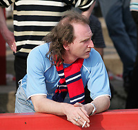 Photo. Andrew Unwin<br /> Doncaster Rovers v York, Nationwide League Division Three, Earth Stadium, Belle Vue, Doncaster 24/04/2004.<br /> A York City fan looks dejected after the loss that will see his team relegated.
