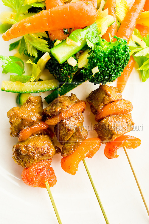Lamb Sosaties (South African style spicy lamb kebabs with apricots). Autumn Vegetable Salad with Orange, Cumin and Mint Vinaigrette. By Ruth Pretty.