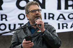 London, UK. 11 January, 2020. Ben Jamal, Director of Palestine Solidarity Campaign, addresses the No War on Iran demonstration in Trafalgar Square organised by Stop the War Coalition and the Campaign for Nuclear Disarmament to call for deescalation in the Middle East following the assassination by the United States of Iranian General Qassem Soleimani and the subsequent Iranian missile attack on US bases in Iraq.