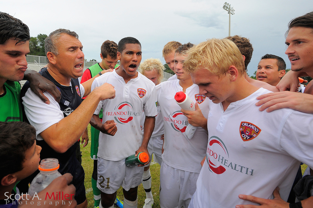 Orlando City coach Joe Avallone and his team celebrate their 4-2 over the Austin Aztex  in the PDL Southern Conference Championships final at Trinity Catholic High Schooll on July 22, 2012 in Ocala, Florida. ..©2012 Scott A. Miller