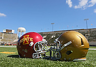 September 08 2012: Iowa State and Iowa helmets on the field before the start of the NCAA football game between the Iowa State Cyclones and the Iowa Hawkeyes at Kinnick Stadium in Iowa City, Iowa on Saturday September 8, 2012. Iowa State defeated Iowa 9-6.