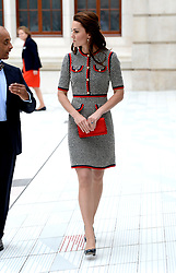 The Duchess of Cambridge at the Victoria and Albert Museum, where she officially opened its new exhibition gallery, in London. She appears to have the illusion of a baby face or Casper The Friendly Ghost on her knee. Picture credit should read: Doug Peters/EMPICS Entertainment