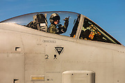 "A Thunderbolt A-10 pilot gives the ""hook 'em horns"" gesture while readying for a mission.  Nellis AFB, Las Vegas, Nevada.  <br />
