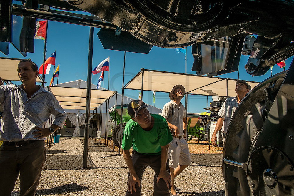 "2015/03/06 – Km 215 between Rosário and Buenos Aires, Argentina: Farmers look at ""a mosquito"", used to apply agro-chemicals in agriculture fields like soy, on the Expo Agro fair, where producers have the change to see new lines of  agriculture machinery.  (Eduardo Leal)"