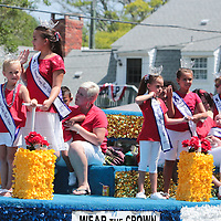 Parade participants wave to spectators during the North Carolina 4th of July Festival Parade Friday July 4, 2014 in Southport, N.C.