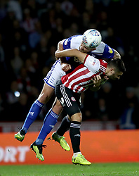 Birmingham City's Harlee Dean battles for possession of the ball with Brentford's Neal Maupay, (right)