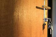 Keys left in the lock of a slightly open door