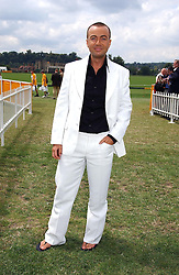 Fashion designer JULIEN MACDONALD at the Veuve Clicquot sponsored Gold Cup or the British Open Polo Championship won by The  Azzura polo team who beat The Dubai polo team 17-9 at Cowdray Park, West Sussex on 18th July 2004.
