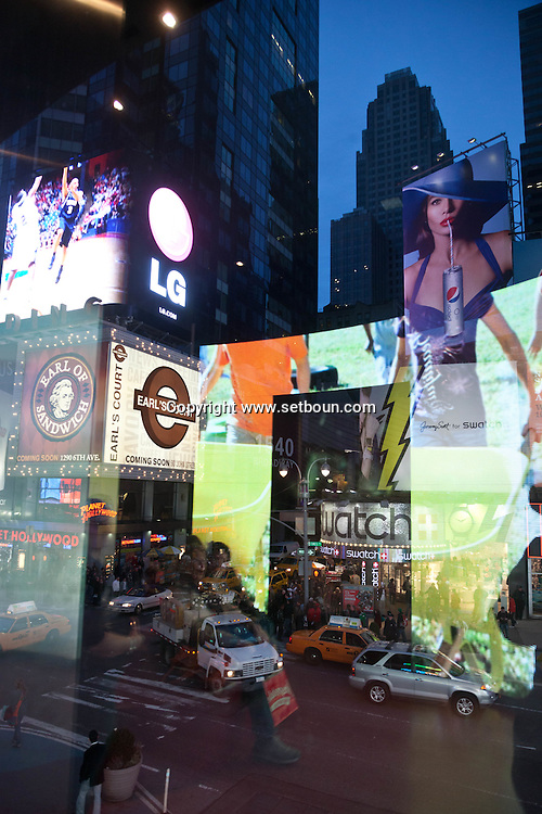 New York, Times square street life at night  on broadway, strange light and reflections