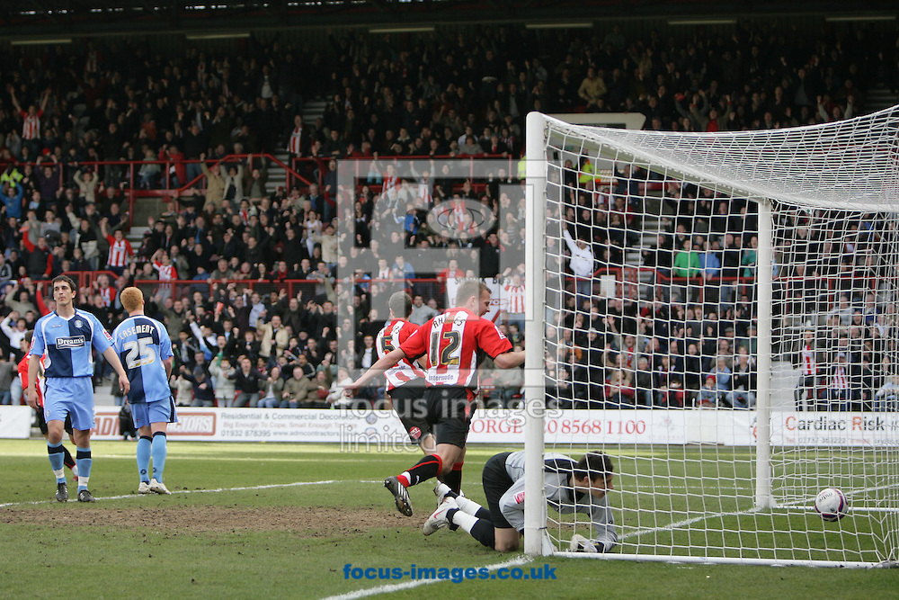 London - Saturday, March 14th, 2009: Jordan Rhodes (C) of Brentford celebrates as team mate David Hunt's (hidden) free kick beats Wycombe Wanderers goalkeeper Marek Stech for his side's second goal during the Coca Cola League Two match at Griffin Park, London. (Pic by Mark Chapman/Focus Images)