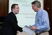 Ken Hartung (right) greets speaker Hunter Arnold, Vice President of Sales for CareerBuilder.com, during The Ralph and Luci Schey Sales Centre's 10th Annual Sales Symposium at O.U. on Friday, 4/20/07.