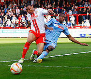 Darius Charles of Stevenage is tackled by Stephen Arthurworrey of Tranmere Rovers during the Sky Bet League 1 match at the Lamex Stadium, Stevenage<br /> Picture by David Horn/Focus Images Ltd +44 7545 970036<br /> 08/03/2014
