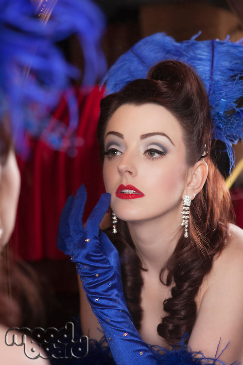 Showgirl checking herself in mirror