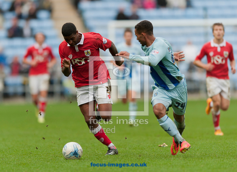 Mark Little of Bristol City looks to out-pace Jordan Clarke of Coventry City during the Sky Bet League 1 match at the Ricoh Arena, Coventry<br /> Picture by Russell Hart/Focus Images Ltd 07791 688 420<br /> 18/10/2014