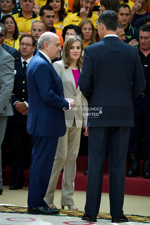 King Felipe VI of Spain and Queen Letizia of Spain attend and audience to a representation of the members of the Security Forces of State Security, Local Police and Emergency Services of the City of Madrid participants devices during acts of Proclamation of Felipe VI at Palacio del Pardo on July 30, 2014 in Madrid